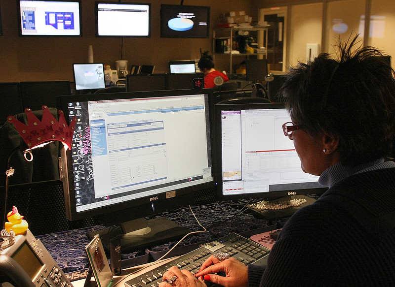 Cherokee Nation Technologies helpdesk employee Rhanna Simmons works to correct a users issue.