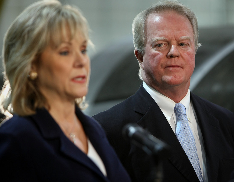 Oklahoma Governor-elect Mary Fallin looks on as Tulsa businessman Robert Sullivan, Jr. speaks at a press conference after being announced he will serve as Special Advisor to the Governor on Economic Development.