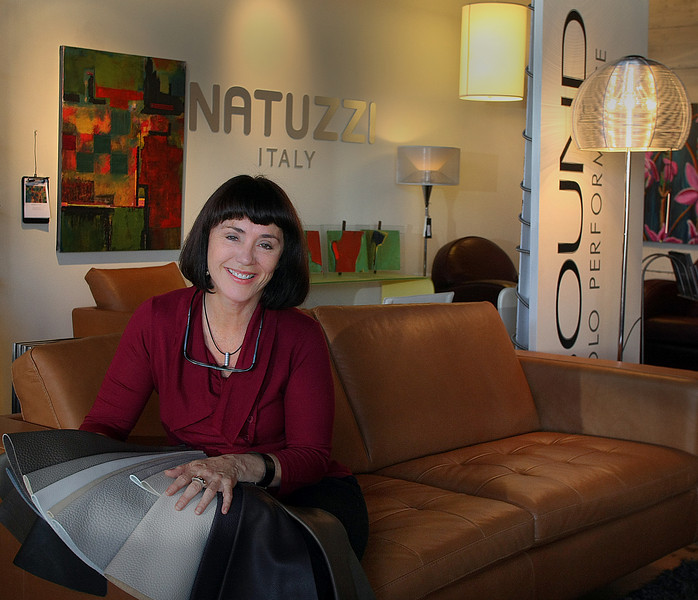 Rebecca Joskey, Owner of Urban Furnishings in Tulsa, shows a small selection of the different leather finishes available on Natuzzi furniture her shop sells.
