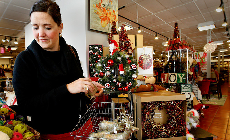 Kristi Miers gets in a little early Christmas shopping Monday at Utica Square Shopping Center in Tulsa.
