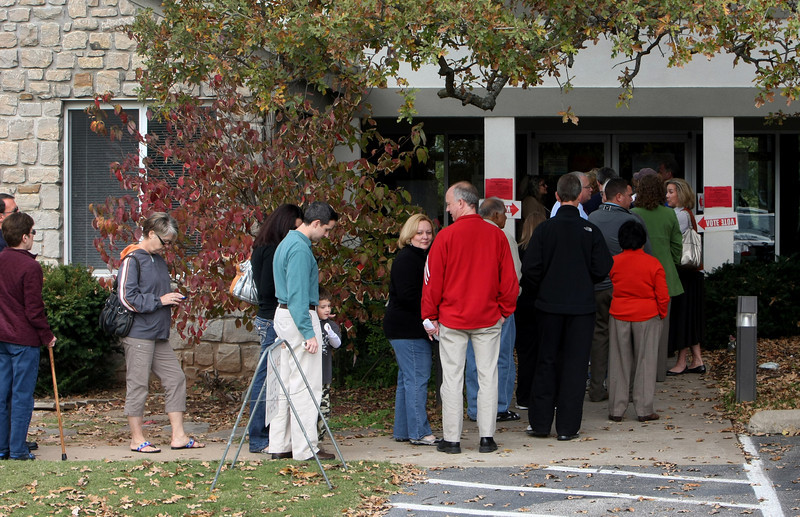 Voters stand in line outside a South Tulsa polling site to cast their ballot in Tuesday's election.