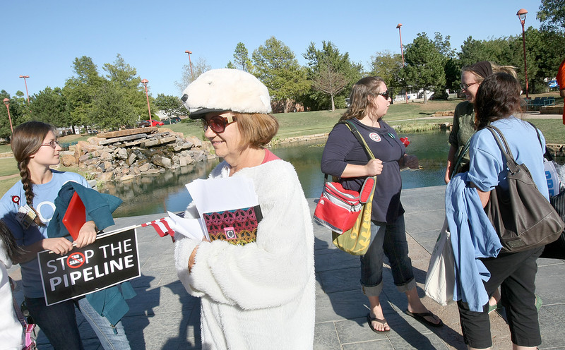 Jean McMahon is dresed like a polar bear in protest of building the Keystone XL pipeline Friday in front of the Reed Center protestors and supporters alike showed up in great numbers.  PHOTO BY MAIKE SABOLICH
