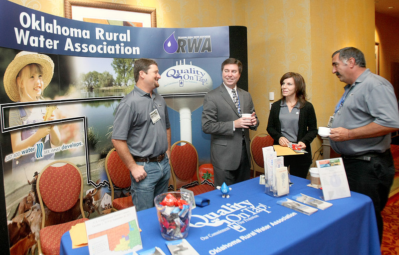 JR Welch, James Gammill, Geannie Anthony and Kelly Matheson with the Oklahoma Rural Water Association during the conference at the Embassy Suites in Norman Tuesday.  PHOTO BY MAIKE SABOLICH