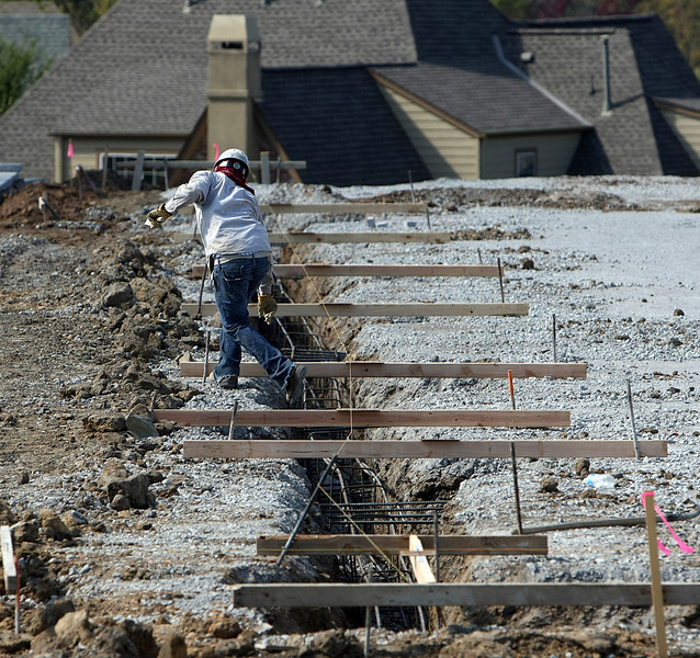 Crews work laying the foundation of the Parkhill South Liqour store in Tulsa.