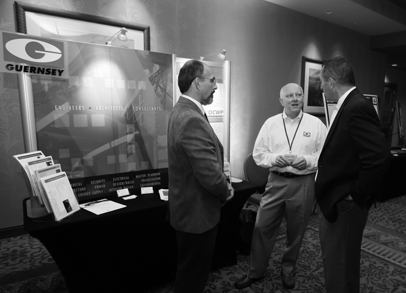 Mike Langston, Jim Senour and Duane Smith visit in the exhibit area during the Water Resources Board conference at the Embassy Suites Tuesday. PHOTO BY MAIKE SABOLICH