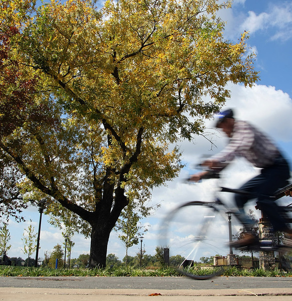 A bicyclist take advantage of the beautiful weather and get a mid-day ride in on the River Parks trail in Tulsa.