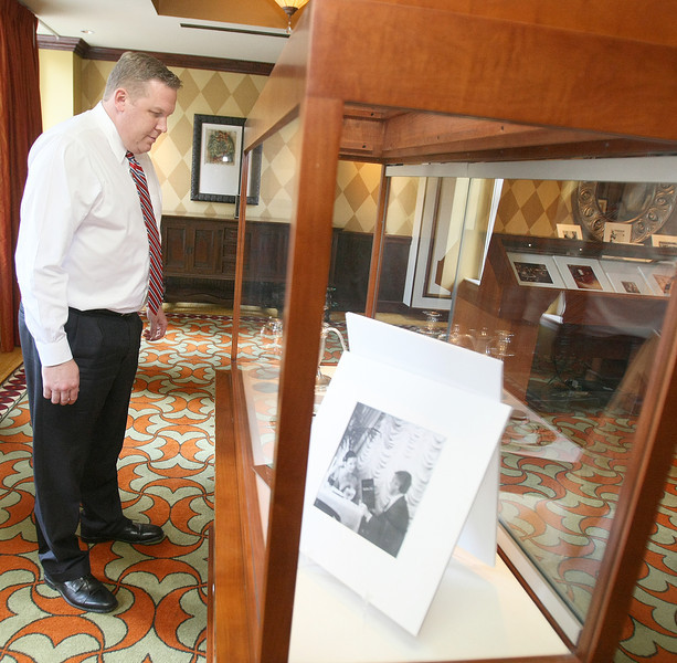 Patrick Foppe  checks out an exhibit of historical pictures and articles about the Skirvin Tuesday at the hotel's second floor. PHOTO BY MAIKE SABOLICH
