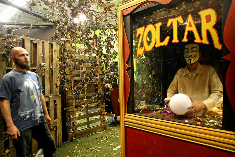 Derek Christopher and Andrew Deruiter works on the Zoltar booth at the Hex House haunted house in Tulsa.