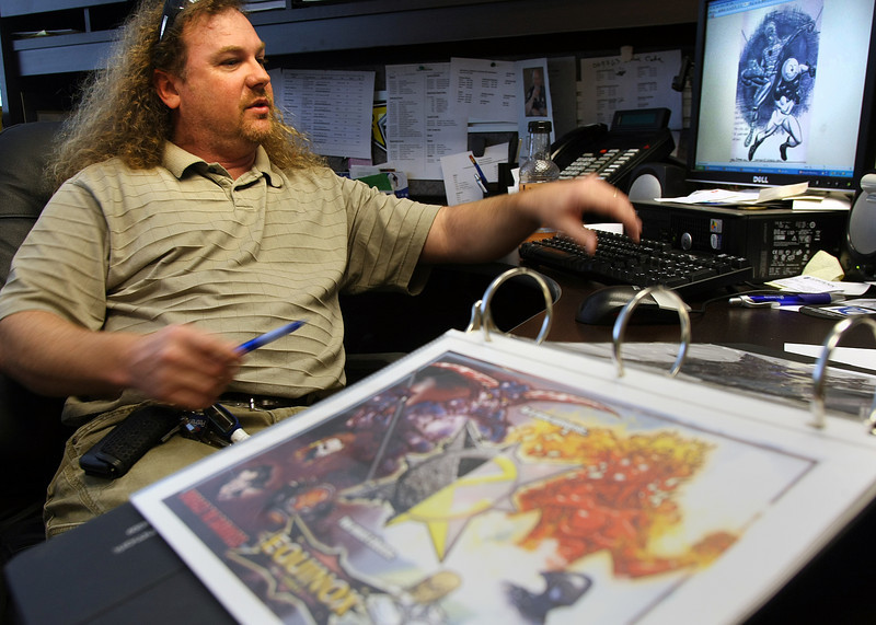 Aaron Ballinger of Equinox comics works on one of the characters in development for a new comic book in development.