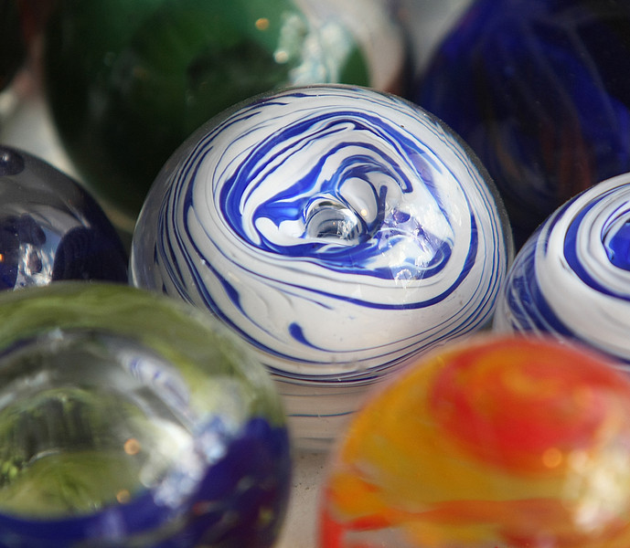 Hand blown glass paperweights created at the Tulsa Glassblowing Studio located in the Brady Arts District in Tulsa.