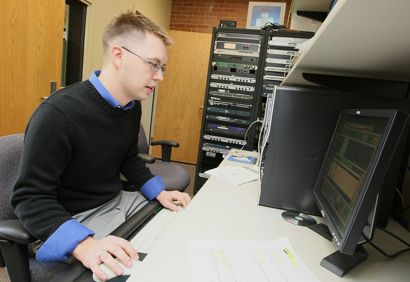 Brian Hardzinski, operations director at KGOU, looks through the daily playlist at the radio station. PHOTO BY MAIKE SABOLICH