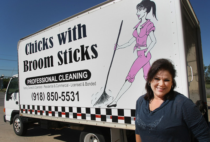 Lisa Johnson stands besides her company's truck.