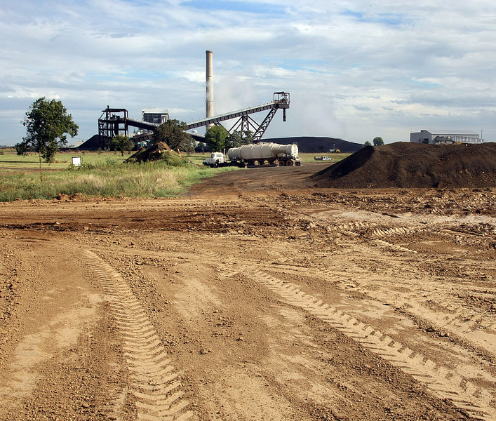 A truck that dispose of fly ash heads back to the PSO electric generation plant in Oologah for another load.  The unburned coal can be seen in the distance.