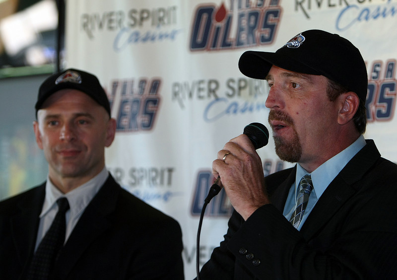 As General Manager on the Tulsa Oilers Taylor Hall looks on Coach of the Tulsa oilers Bruce Ramsay announces the team will be and affiliate of the Colorado Avalanche CHL franchise.