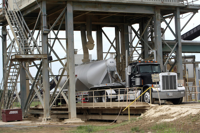 A truck loads a load of fly ash at the PSO electric generation plant in Oologah.