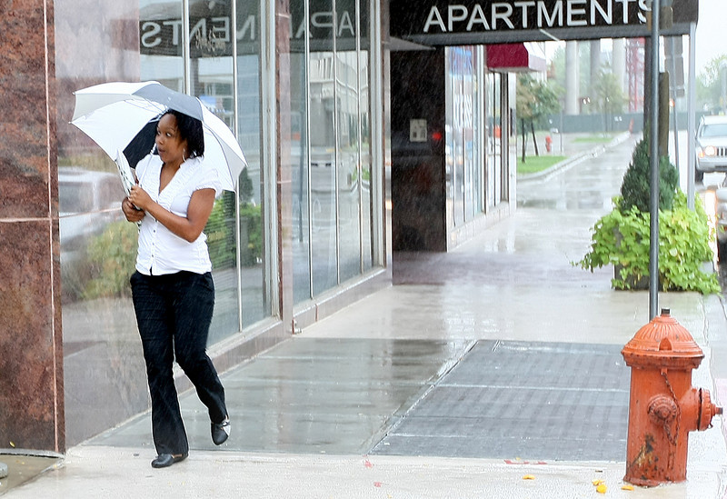 Rita Moore walks through the rain in downtown Oklahoma City Wednesday. PHOTO BY MAIKE SABOLICH