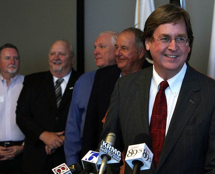 Surrounded by other mayors and city managers Tulsa Mayor Dewey Bartlett holds a news conference to discuss municipalities collecting their own sales taxes.