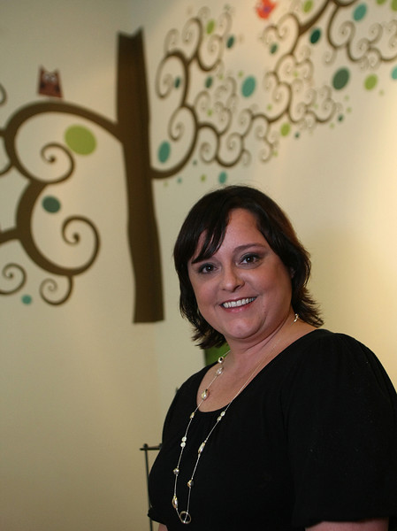 Shelly Bedingfield, Owner of Wall Struck, in front of one of the custom wall decorations she designs and sells.