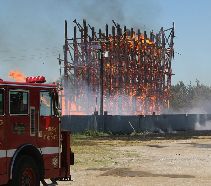 Firefighters battle a blaze at The Admiral Twin Drive that consumed the main screen  Friday afternoon. The historic Admiral Twin drive in opened in 1951.