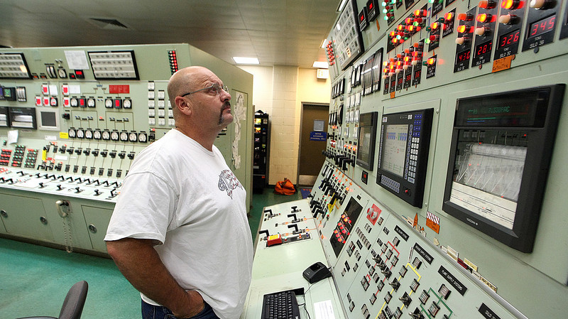 A technician checks guages and monitors the PSO coal fired electrical generation plant in Oolagah.