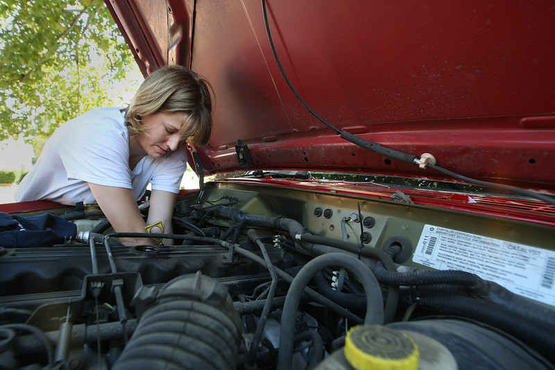 K.C. Clayton, Owner of Loob Job, works to change oil on a vehicle. ****ADD  ADITIONAL CUTLINE INFO AS NEEDED****