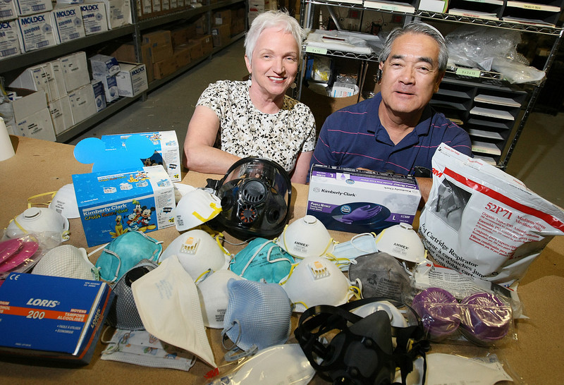 Marilyn and Tim Kawakami with Masks N More in Edmond. lPHOTO BY MAIKE SABOLICH