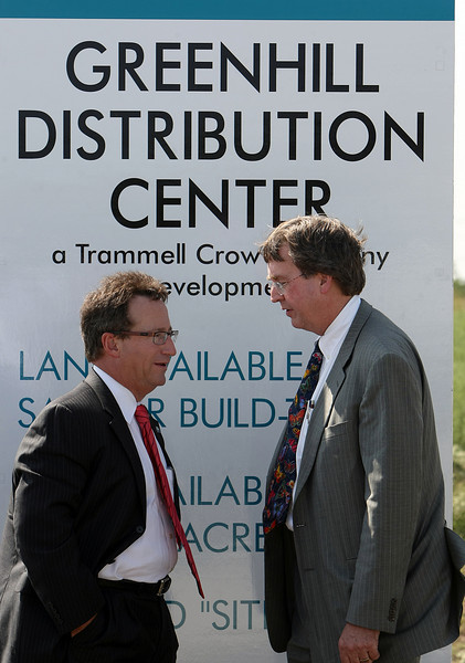 President and CEO of the Tulsa Chamber of Commerce Mike Neal and Mayor of Tulsa Dewey Bartlett chat after participating in the ribbon cutting of the Greenhill Distribution Center in North Tulsa.