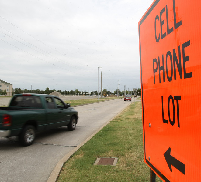 Vehicles follow the signs to the Tulsa International Airports recently opened Cell Phone Lot where they can wait until arriving passengers call and request they pick them up at the concourse.