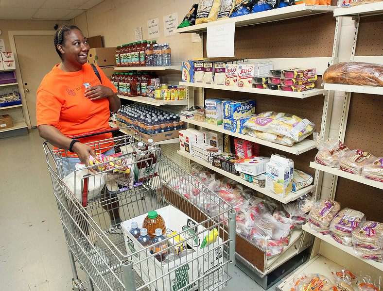 Other Options' client Clarice Robinson shops at the organization's food pantry Wednesday. PHOTO BY MAIKE SABOLICH