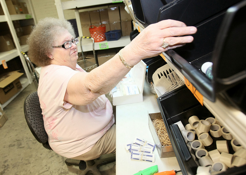 Joan Kuikendall is putting together a first aid kit at NewView Oklahoma Monday. PHOTO BY MAIKE SABOLICH
