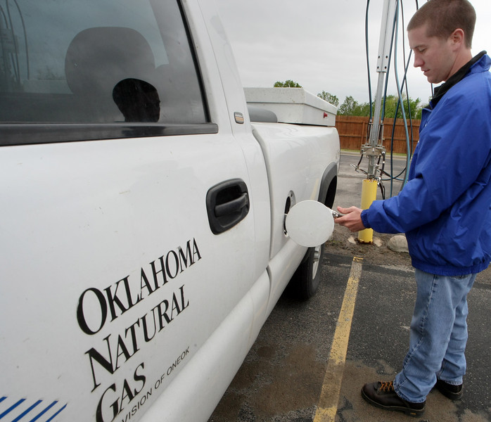 Jeremy Aldridge, Team Leader with Oklahoma Natural Gas, fuels company vehicle with CNG at the companies West Tulsa Facility.