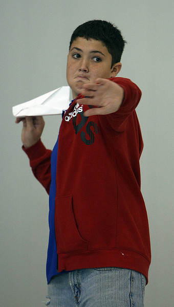 Brycen Whistance of Catoosa launches his paper airplane during a contest at the Tulsa Technology Centers Engineering Challenge in Jenks.  Whistances plane flew over 40 feet.