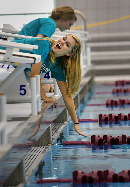 A spectator at the Jenks High School grand opening of the Jenks Aquatic Center reacts to the warm water temperature of the pool.  The 13,500 Sq Foot Center houses an Olympic size swimming pool and can seat 1200 spectators.