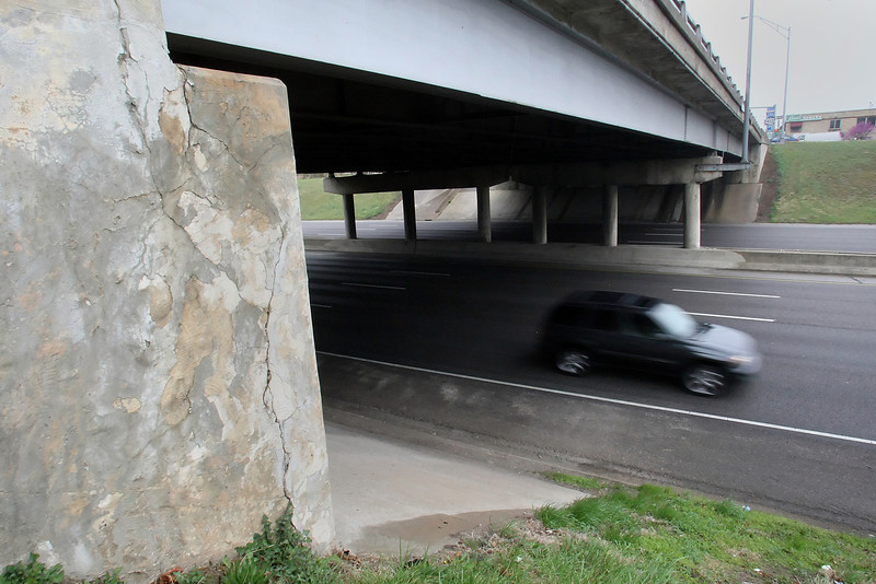 Cars pass under a bridge that needs repair at I-244 and Harvard in Tulsa.