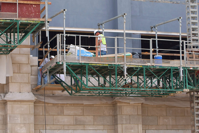 Workmen apply stone as part of a multi-million dollar addition to the First Presbyterian Church in downtown Tulsa.