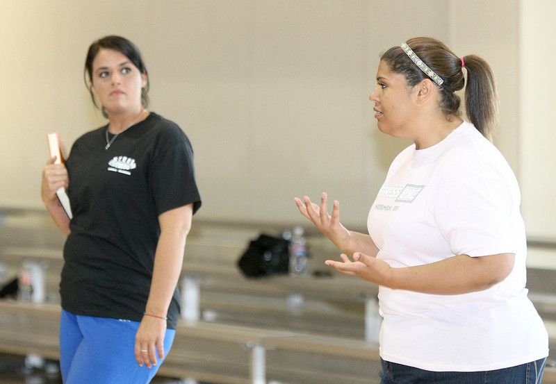 Former Biggest Looser contestants Allie Ishcomer, right, and Lisa Mosley teach a fitness boot camp together at First Baptist Church in Moore. PHOTO BY MAIKE SABOLICH
