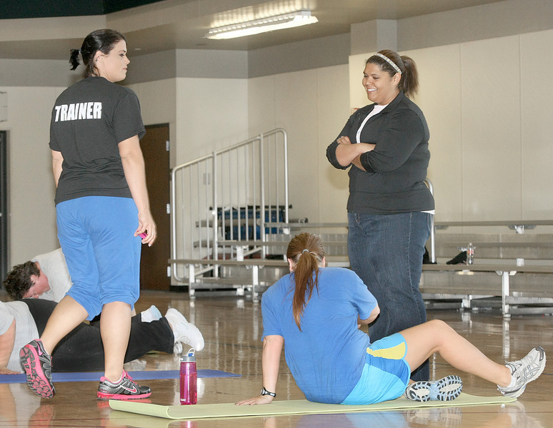 Former Biggest Looser contestants Lisa Mosley, right, and  Allie Ishcomer teach a fitness boot camp class together at First Baptist Church in Moore. PHOTO BY MAIKE SABOLICH