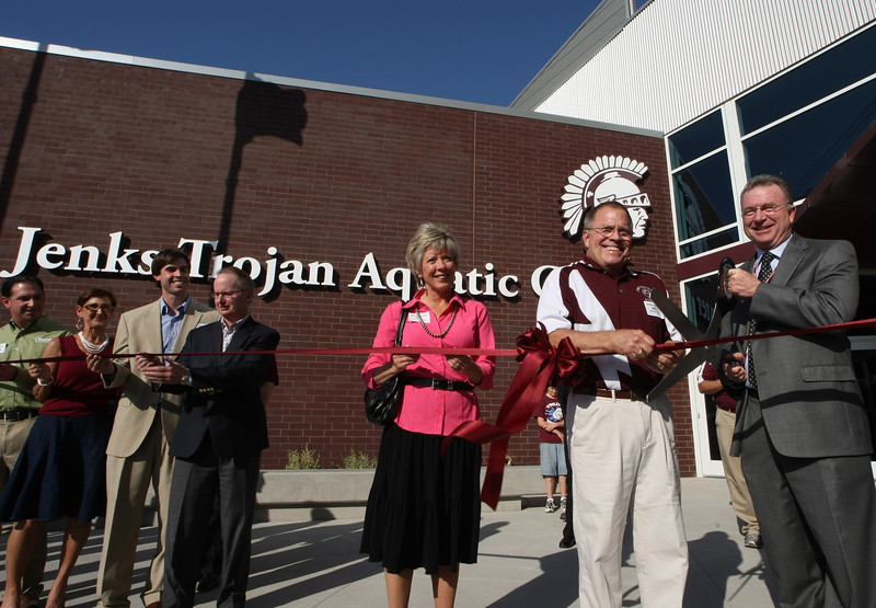 Jenks High School swimming coach John Turner helps cut the ribbon on the new Jenks Aquatic Center.  The 13,500 Sq Foot Center houses an Olympic size swimming pool and can seat 1200 spectators.