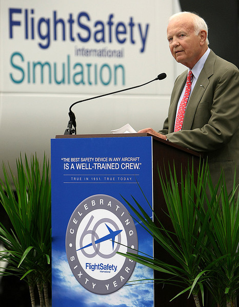 Bruce Whitman, President & CEO of Flight Safety International speaks to the crowd at the Grand Opening of Flight Safety's new Facility in Broken Arrow.