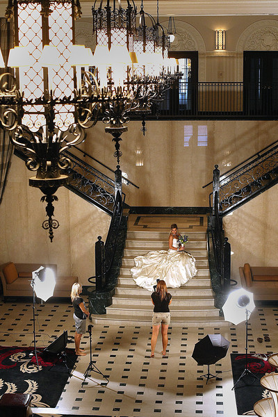 A bride poses for her wedding photograph on the grand stairway of the Mayo Hotel in Downtown Tulsa.