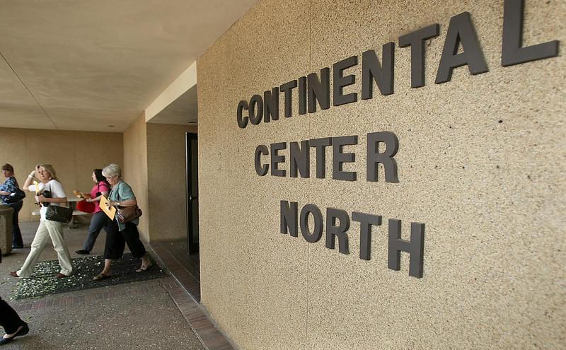 People exit Continental Tower North Tuesday.  PHOTO BY MAIKE SABOLICH