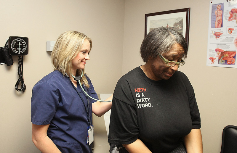 Emily Fallwell, nurse practitioner with Variety Care, listens to Jeanetta Fairman's breathing at Northcare Behavioral Health Center in Midtown Thursday.  PHOTO BY MAIKE SABOLICH