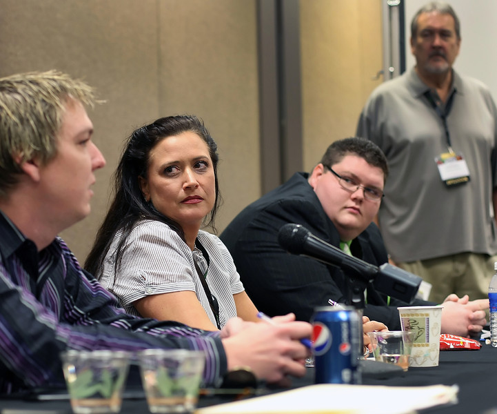 "Panelists cage fighting promoter Dale ""Apollo"" Cook, Amy Tall Chief Entertainment Director for the Osage Casino and Marketing Manager for the Sugar Creek Casino Rocky Coleman speak at a breakout session at the Oklahoma Indian Gaming Conference in Tulsa."