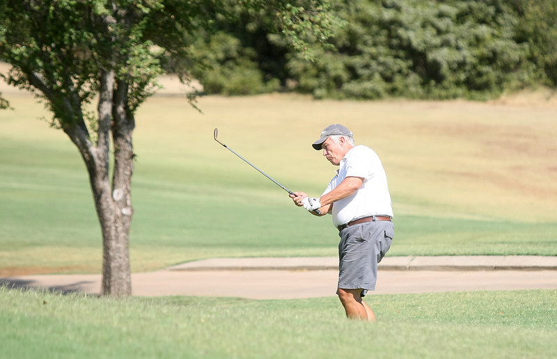 Al Hoos plays golf at Hefner Lake North Monday. PHOTO BY MAIKE SABOLICH