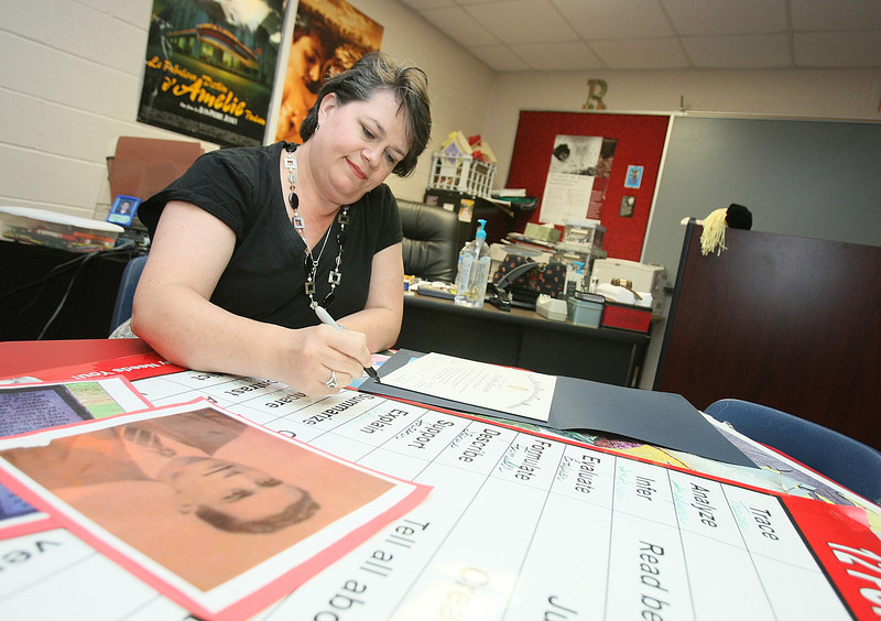 Nationally certified teacher Elise Robillard prepares her classroom Tuesday at Westmoore. PHOTO BY MAIKE SABOLICH