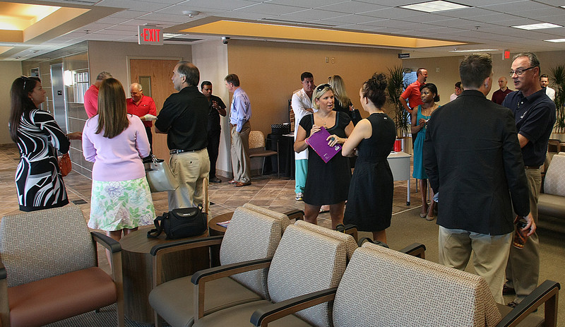 Attendees mingle after and the ribbon cutting at the Tulsa Bone and Joint Orthopedic Urgent Care Center.