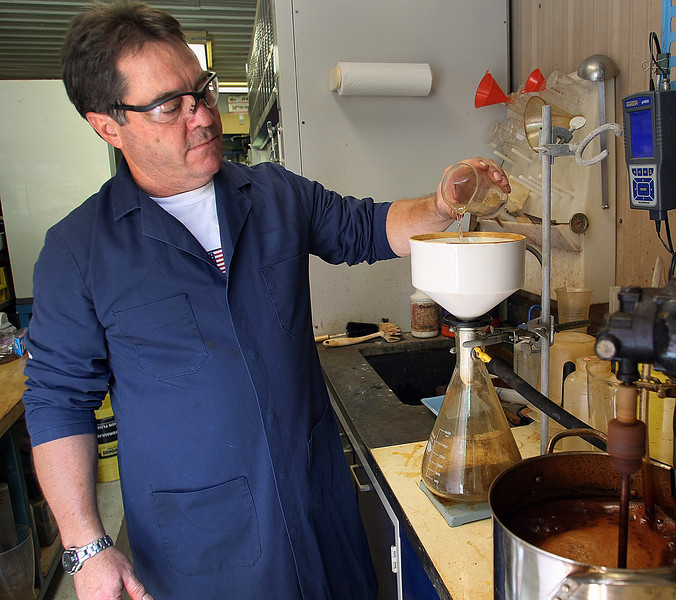 Mike Callaway, President of CalTech Global, works in the companies Sapulpa lab.