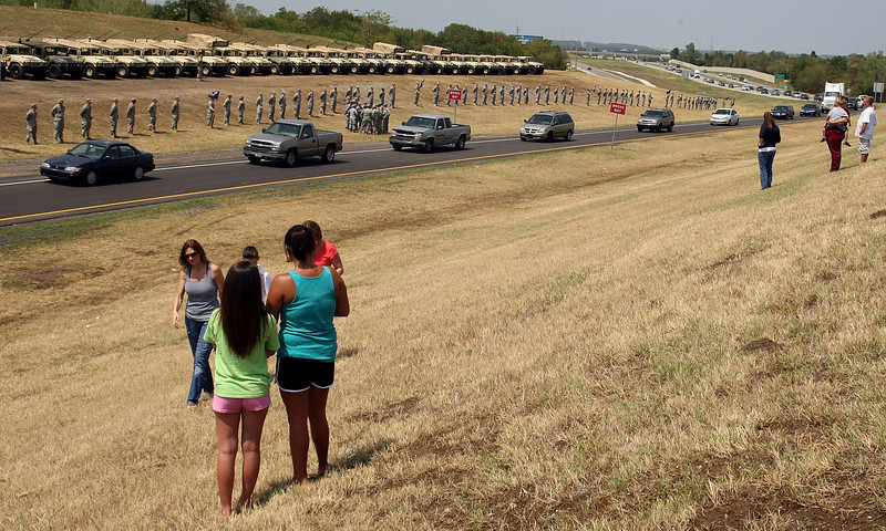 People lining the road to pay respects to Sergeant Kirk Owen, killed last week while on patrol in Afghanistan, passes by as he returns home Friday. The 37-year-old father of two was on his second tour of duty. He was one of four soldiers killed in the deadliest week Oklahoma's National Guard has faced since the September 11th terror attacks.