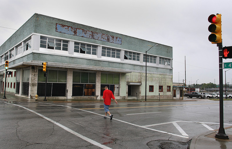 A pedestrian crosses the street at the corner of 4th and Elgin in downtown Tulsa.  Many of the buildings on the block will be repurposed into retail establishments and apartments.<br /> <br /> *** copy desk*** contact Kirby about exact details about this project