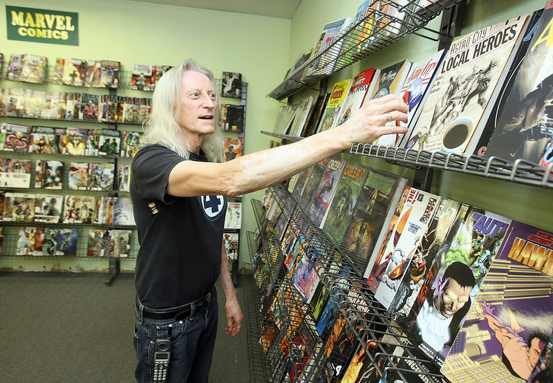 Wyll Greenwood with All Star Comics at his store on North May Friday. PHOTO BY MAIKE SABOLICH